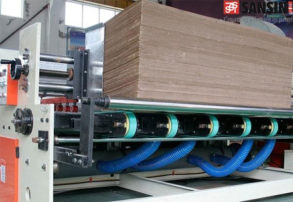 bộ phận cấp giấy của máy dán thùng tự động