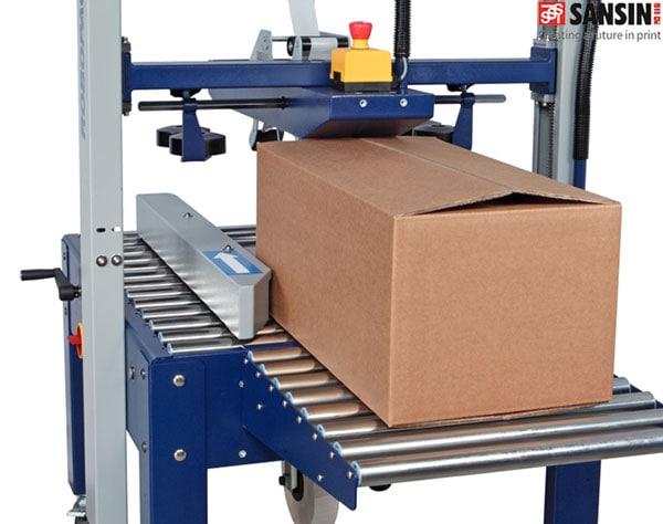 bộ phận chỉnh lệch và bộ phận dẫn giấy của máy dán thùng carton tự động tại cần thơ
